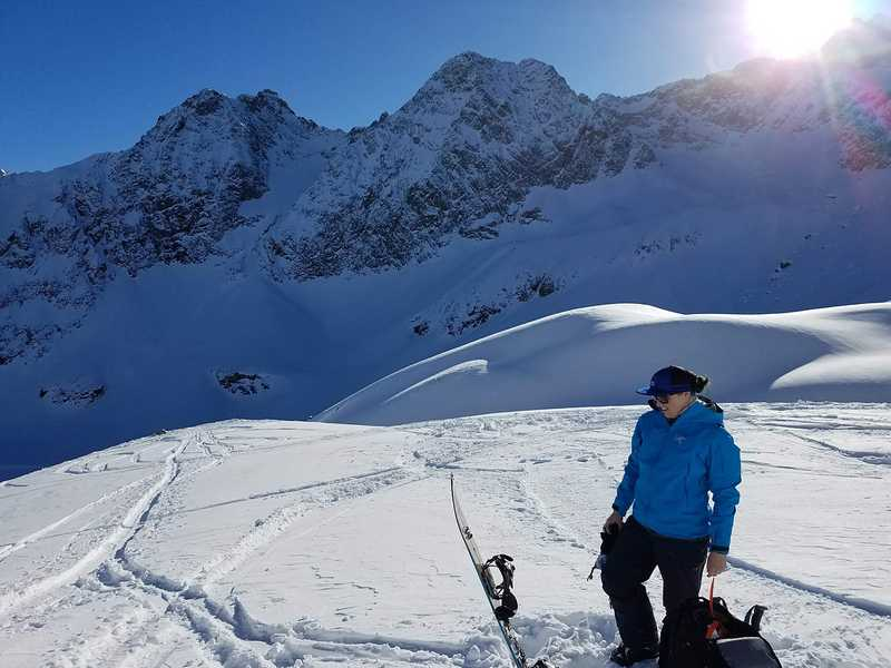 Me transitioning my splitboard after a large snowy climb in Austria